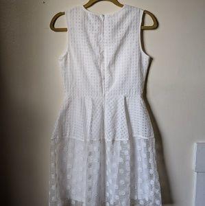 Pretty & multi texture white dress by Ivanka Trump